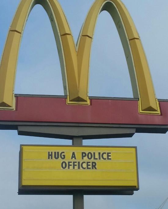 hug-a-cop-mcdonalds-sign
